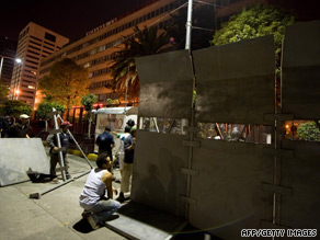 Police erect a barrier outside the offices of Luz y Fuerza del Centro in Mexico City.