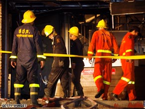 Rescue officials survey the scene of the nightclub fire in Bangkok, Thailand.