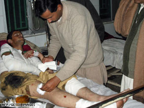 A paramedic treats a victim of a suicide blast at a hospital in Dera Ismail Khan on Sunday.