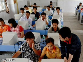 Farmers in China learn how to use the Internet in April 2008 in Guangdong province.