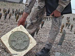 An Afghan soldier inspects a land mine in Herat, western Afghanistan.