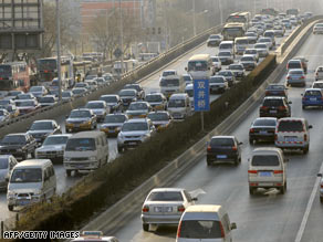 Commuters drive along a road in downtown Beijing, China, on Thursday.