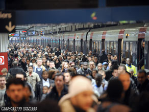 Don't you wish you had stayed home instead? Commuters at the Gare du Nord train station in Paris.