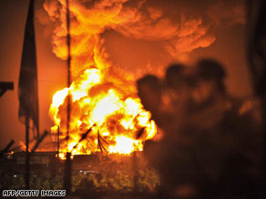 People watch a fire at Jakarta's lone fuel depot on Sunday.