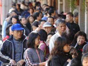 People line up to receive $108 U.S. dollars worth of shopping vouchers in Taipei, Taiwan, on Sunday.