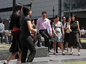 People walk out for their lunch break in the financial district of Singapore on Wednesday.