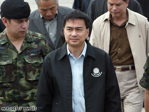 Prime Minister Abhisit Vejjajiva (center) has announced a probe into the treatment of the Rohingya.