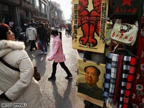 People shop for the Lunar New Year Wednesday in Beijing, China.