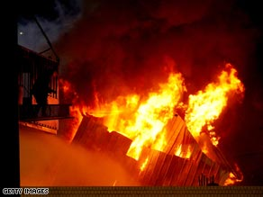 Six people including a police officer were killed in the blaze.