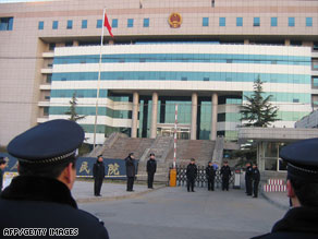 Police surround a court building in northern China in late December during the trial.