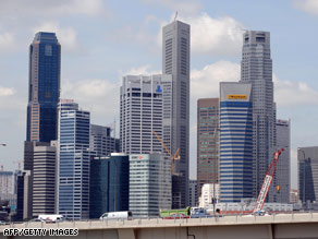 Motorists travel over the bridge against the Singapore skyline on Thursday.