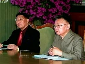 This undated picture, released January 18, 2009, shows Kim Jong Il, centre, while inspecting an army unit.