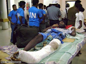 A civilian, injured during fighting in rebel territory, lies on a bed at a hospital in Vavuniya.