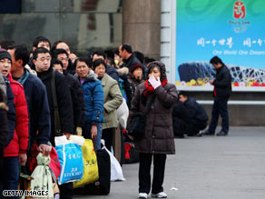 Migrant workers arrive at Beijing's West Railway Station on Monday, despite growing unemployment.
