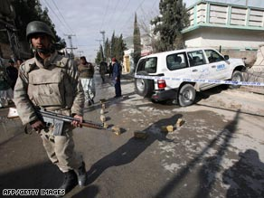 A Pakistani paramilitary soldier stands guard where a U.N. official was kidnapped in Quetta, Pakistan, on Monday.