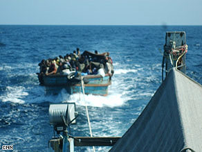 This picture provided to CNN is said to the Thai army towing refugees out to sea.