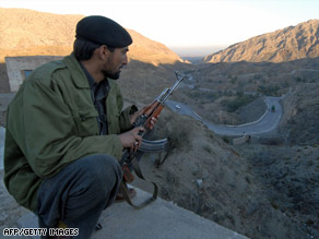 A Pakistani policeman sits near a police check post in the tribal area of Khyber Agency on February 12, 2008.