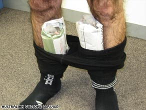 Customs officials in Australia allege that a man tried to smuggle pigeons hidden in his tights.