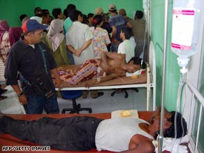 Refugees receive medical treatment Tuesday at a hospital in Idi Rayeuk, Indonesia.