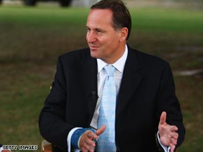 John Key wears the cast during a TV interview on Friday.