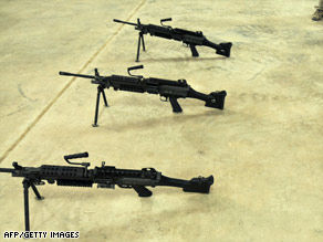 U.S.-issue M249 squad automatic weapons are shown at a camp in Kandahar in December.