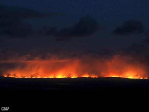A wildfire hits Wilson's Promontory National Park southeast of Melbourne Saturday.
