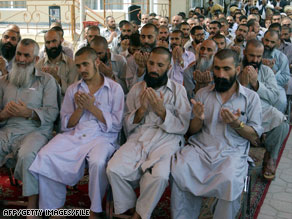 Former detainees pray near Kaubul in 2005 following their release from U.S. custody at Bagram Air Base. 
