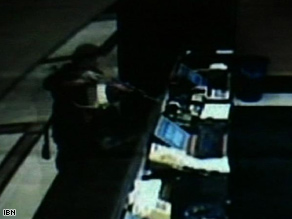 A surveillance video appears to show a gunman shoot at a desk in the Hotel Trident in November.