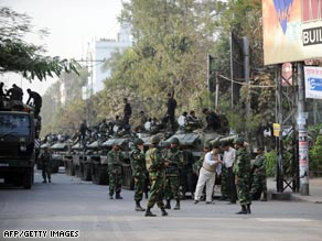 Bangladeshi army soldiers gather near the Bangladesh Rifles headquarters in Dhaka Thursday.