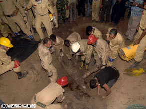Bangladeshi firefighters continued to uncover bodies Friday of Bangladesh Rifles officers from a mass grave.