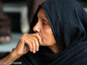 A Bangladeshi woman waits for news of a missing relative at the Bangaldesh Rifles heaquarters in Dhaka.