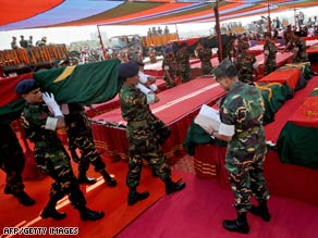 Bangladeshi soldiers carry a coffin during a funeral Monday for victims of last week's mutiny.