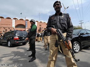 Pakistani policemen outside The National Stadium after masked gunmen attack the Sri Lankan cricket team in Lahore  on March 3, 2009.
