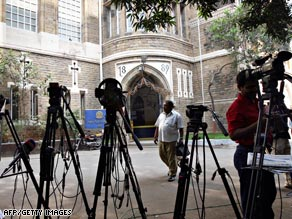 Television crews set up outside Mumbai's Metropolitan Magistrate court where Kasab was charged.