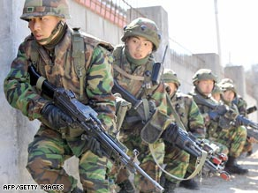 South Korean soldiers move into a building during a joint military exercise with U.S. troops in Pocheon Tuesday.