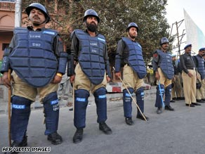 Riot police block a street on Thursday leading to a court building in Karachi, Pakistan.