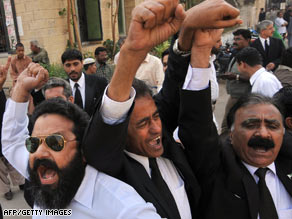 Lawyers shout slogans Thursday in Karachi on the eve of a march to Islamabad.