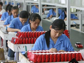 Workers assemble toys on a production line at a factory in Shantou, in China's Guangdong province.