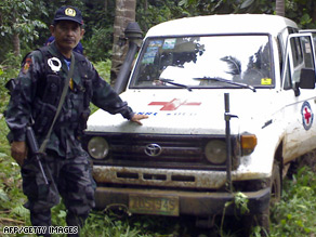 Police recover the abandoned vehicle of the Red Cross workers on Sulu in January.
