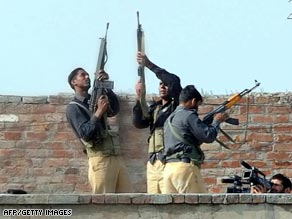 Paramilitary soldiers arrest a suspect near the site of Lahore's police training center.