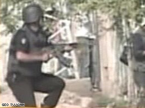 Television footage showed a chaotic scene around the police training facility in Lahore.