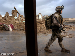A U.S. Marine patrols with his squad Wednesday in the Afghan province of Helmand.