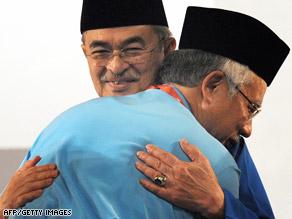 Outgoing Prime Minister Abdullah Ahmad Badawi, facing, hugs his successor, Najib Razak last week.