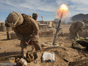 U.S. Marines fire 120mm mortars on Taliban positions on April 3 in Now Zad in Helmand province, Afghanistan.