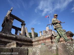 A Cambodian soldier walks past Preah Vihear temple in the Cambodian province of Preah Vihear.