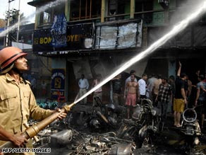 Firefighters attempt to control a fire after an explosion in the Indian city of Guwahati.