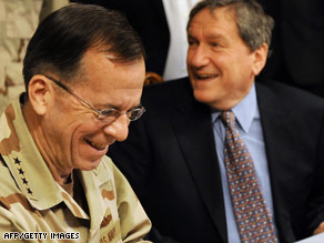 The top U.S. military officer, Mike Mullen, left, and envoy Richard Holbrooke share a laugh Tuesday in Pakistan.
