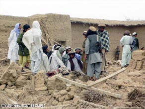 People inspect the damage from a suspected U.S. missile strike in northwest Pakistan last month.