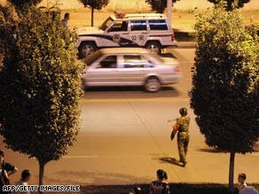 Chinese police patrol on August 4, 2008, in the area of Kashgar where an attack killed 17 people.