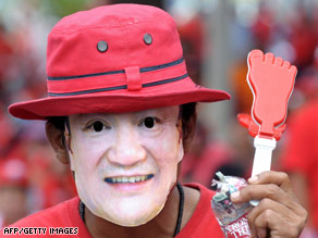 Supporters of Thailand's ousted premier Thaksin Shinawatra rally in Bangkok on Wednesday.
